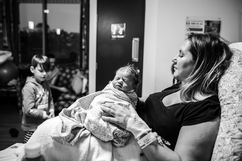 mother holding milk drunk newborn at Casey Hospital