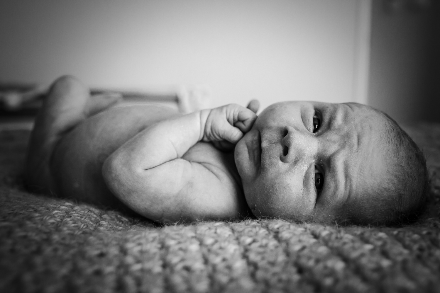 Serious face newborn details during in home lifestyle session