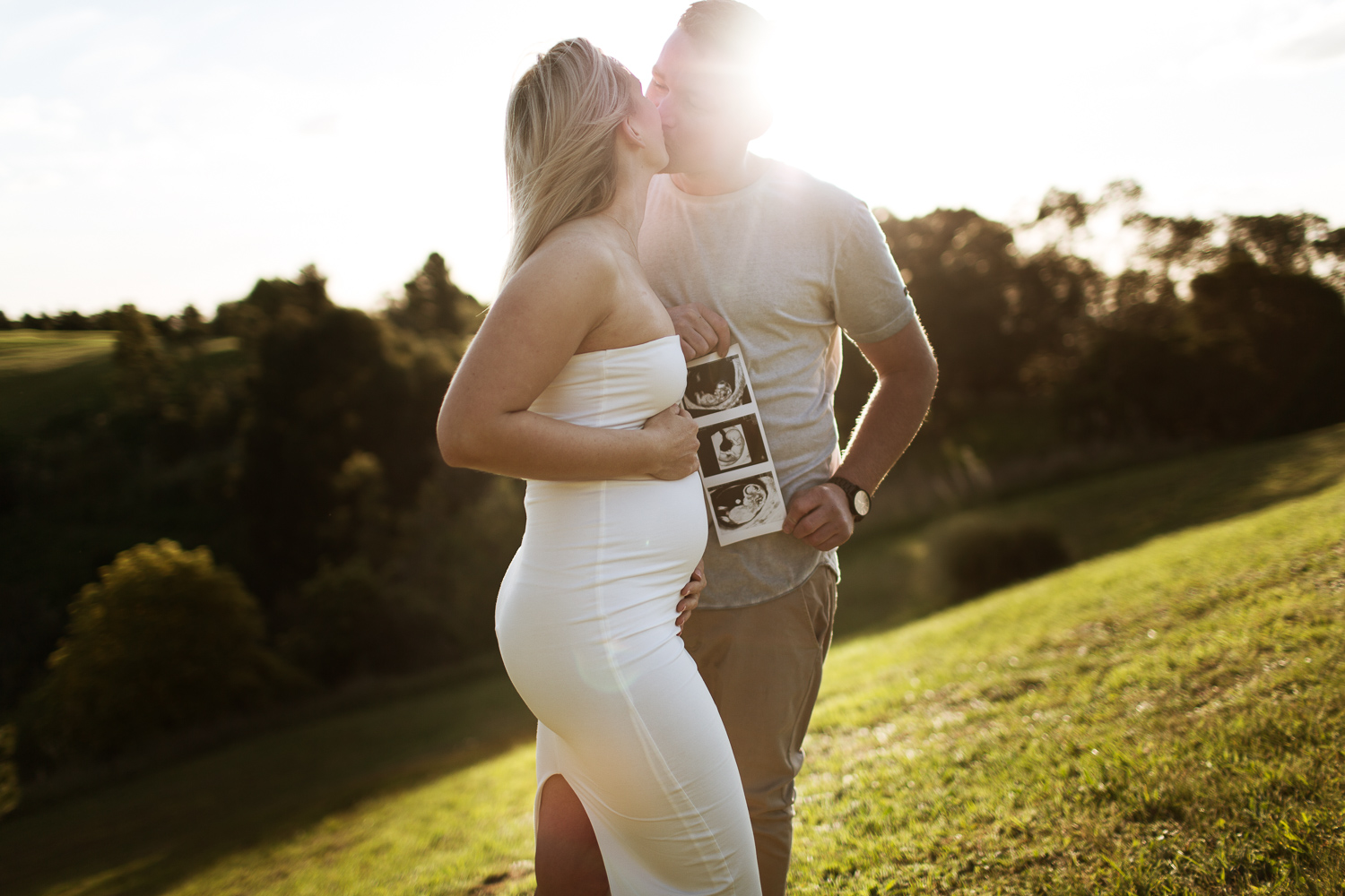 Celebrating their journey into parenthood with a pregnancy announcement photo shoot during golden hour.