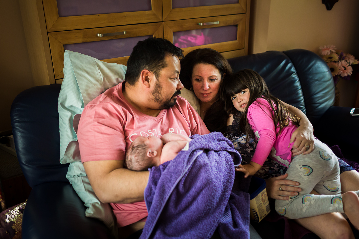 family enjoying some quiet moments after the birth of their newest member at home birth in Melbourne Victoria. Captured by A Grateful Heart Photography