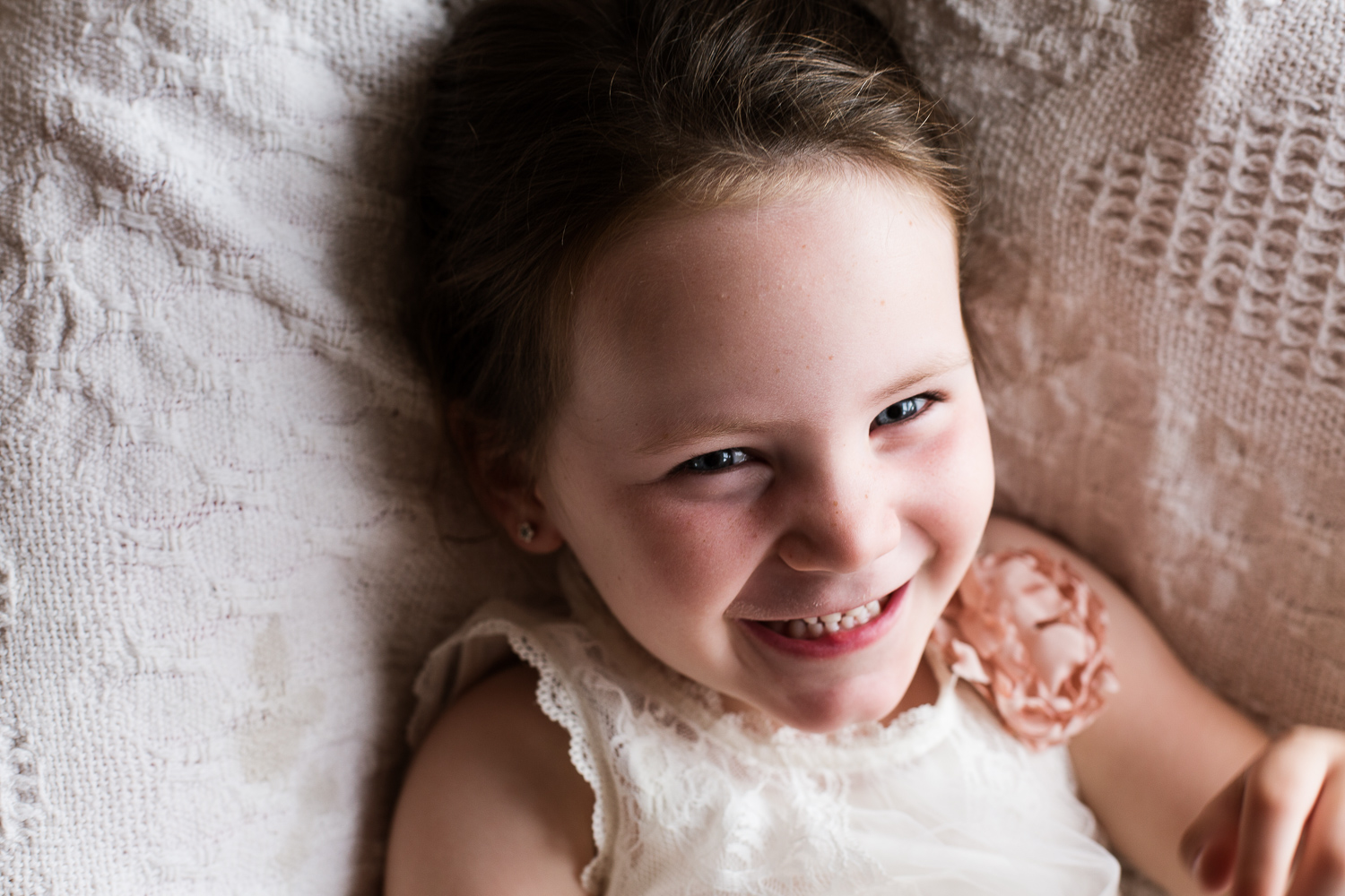 smiling girl captured during lifestyle family session on location at home on Mornington Peninsula
