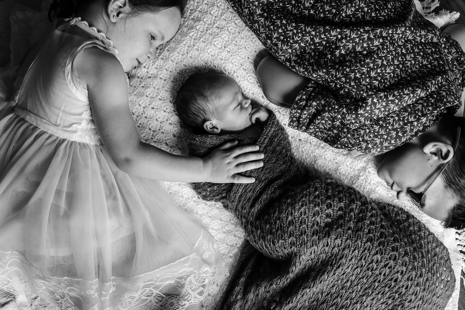 siblings captured in black and white during newborn lifestyle session at Mornington location