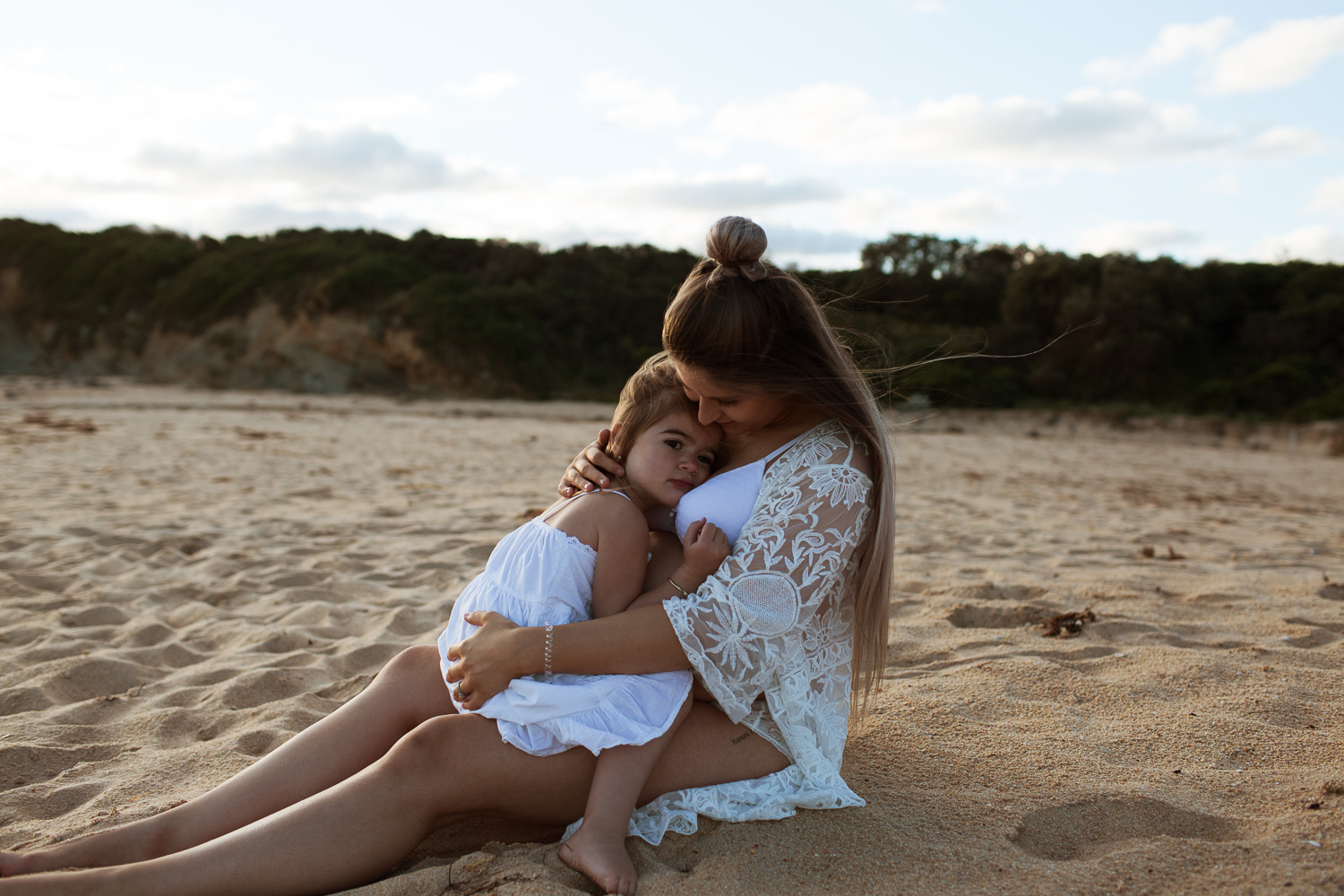 mother and daughter beach