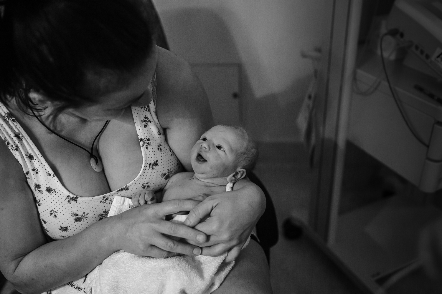 newborn baby smiling at aunty in birth suite at hospital in leongatha.