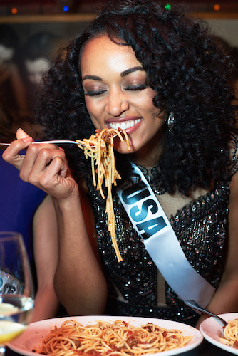 IF THEY CAN'T HAVE BREAD, LET THEM HAVE SPAGHETTI: Miss USA feasts on some pasta