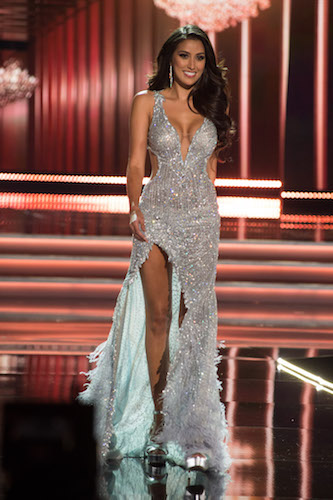 GLAMOUR AND BEAUTY: Miss Philippines sashays on stage during the evening gown competition
