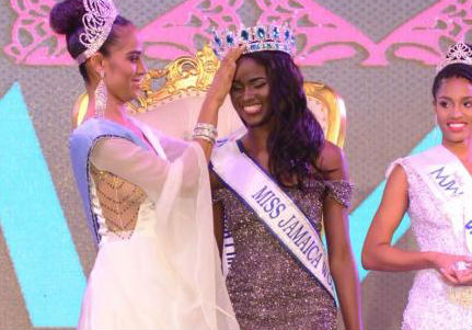 Miss Jamaica World, a top 10 in Miss World and Miss World Caribbean 2017, Solange Sinclair crowned the 2018 queen Khadijah Robinson. At right is the second runner-up, Catherine Harris - Shorn Hector photo (The Gleaner)