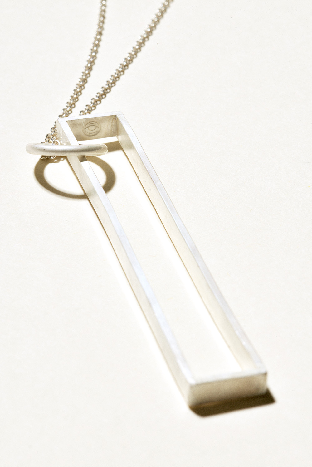 Long Bar Pendant - 3in x .5in on a 36in chainSterling Silver, Raw FinishHand Smithed $200