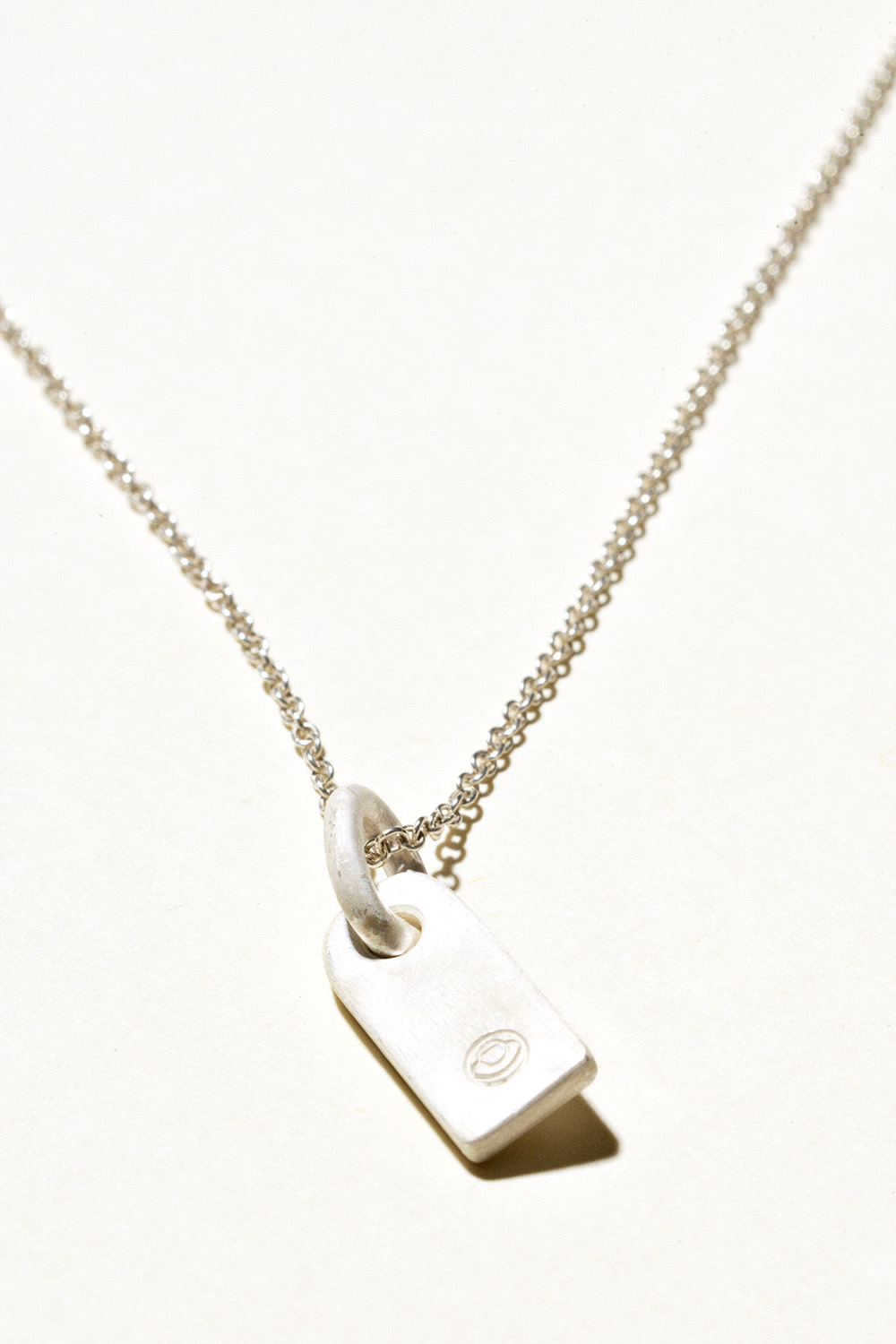 "Tag Necklace - 25mm x 8mm on a 20"" chainSterling Silver, Raw FinishHand Smithed $100"