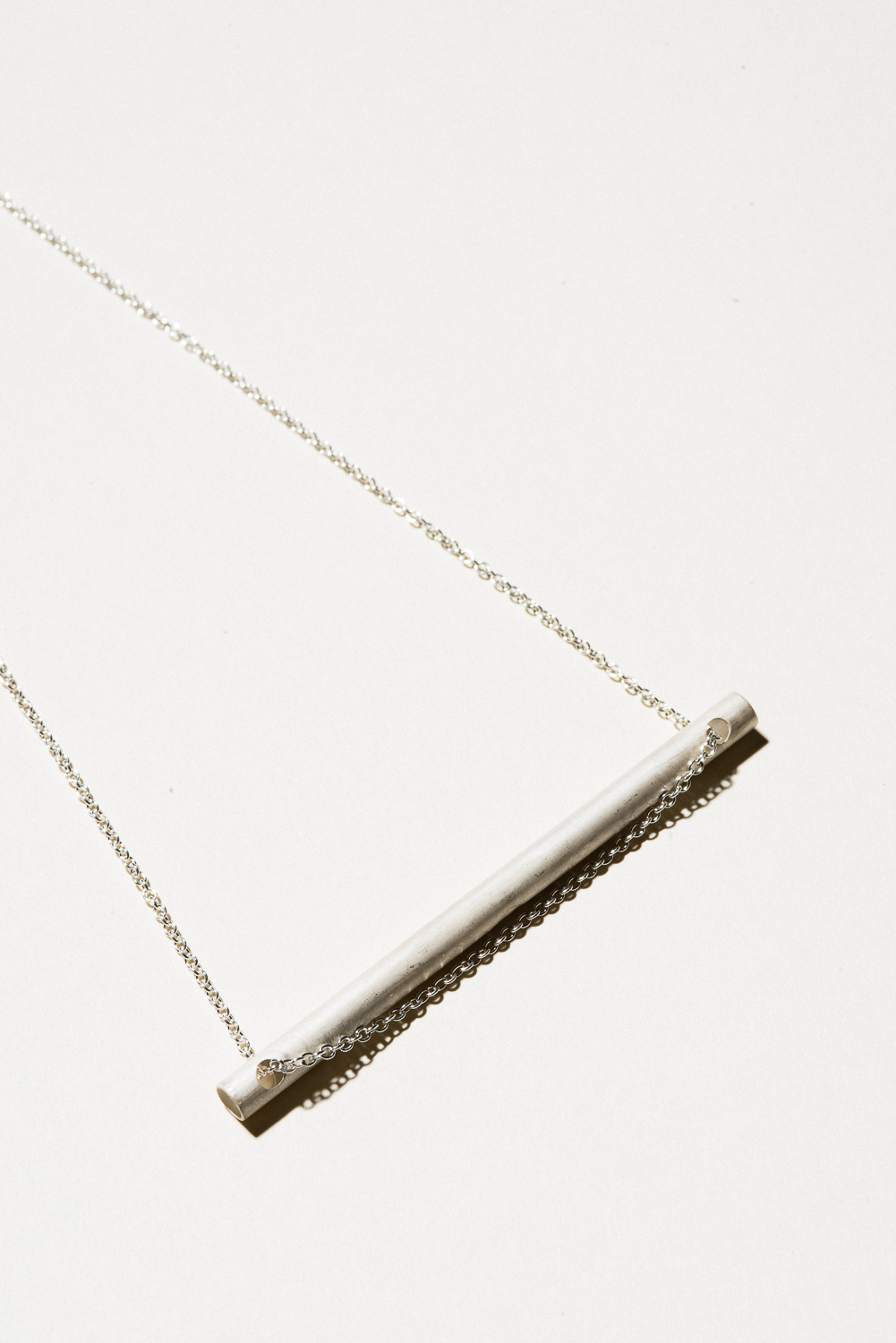 "Silver Tube Necklace - 3"" on a 22"" chainSterling Silver, Raw FinishHand Smithed$100"