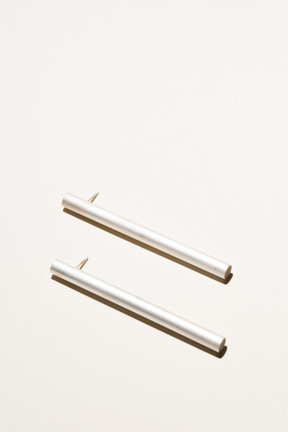 Tube Earrings - 6mm x 3inSterling Silver, Raw FinishHand Smithed$175