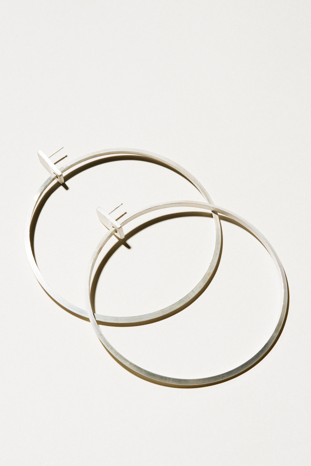 "XL Prism Hoops - 3.5"" diameterSterling Silver, Raw FinishHand Smithed$225"