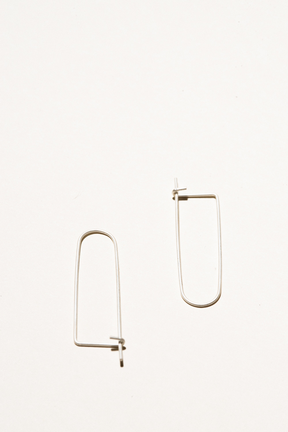 Silver Clippie Earrings - 1.5in longSterling Silver, Raw FinishHand Smithed$40