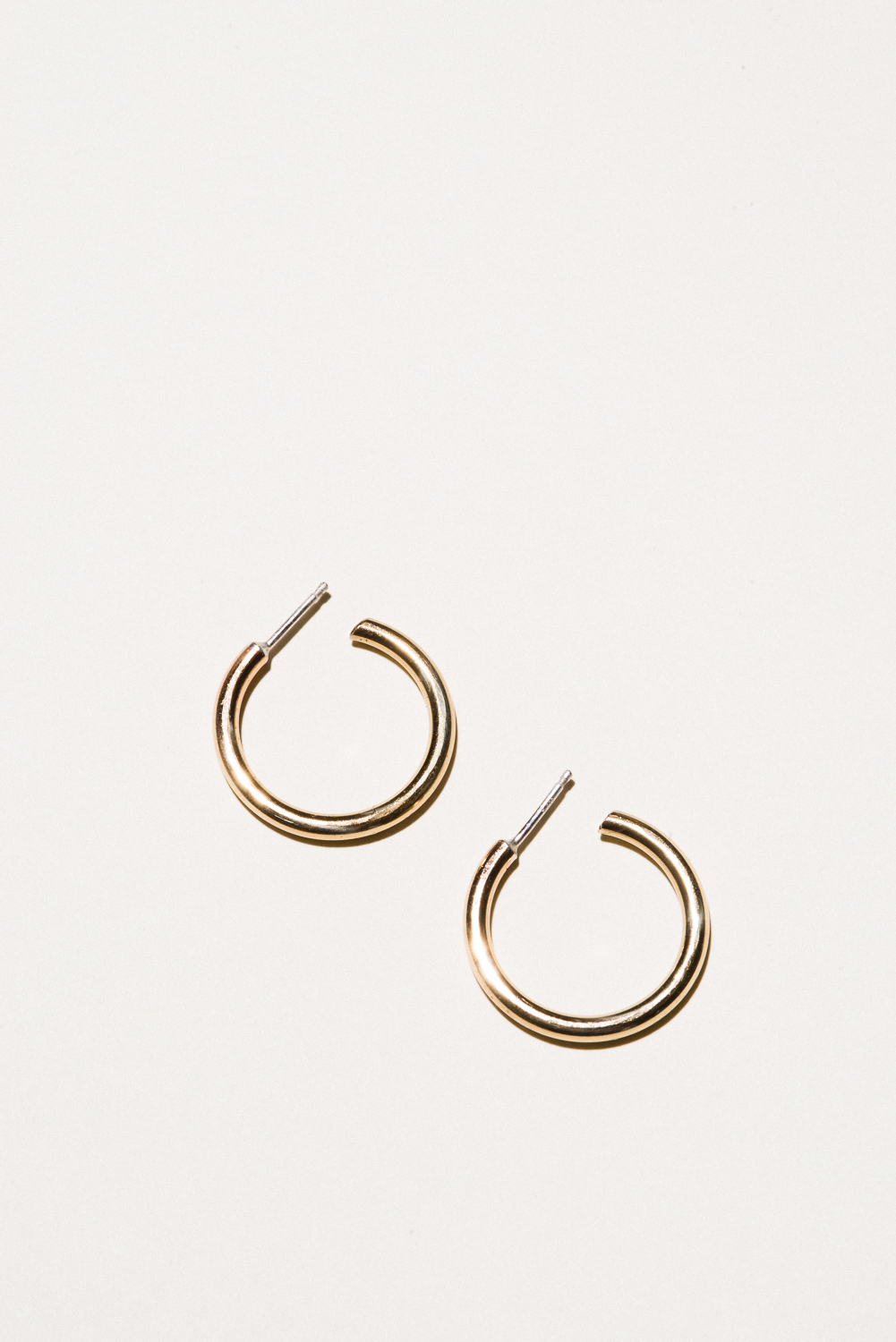 Medium Brass Classic Hoops - .9 in diameterJewelers Brass, Lacquer FinishHand Smithed$50