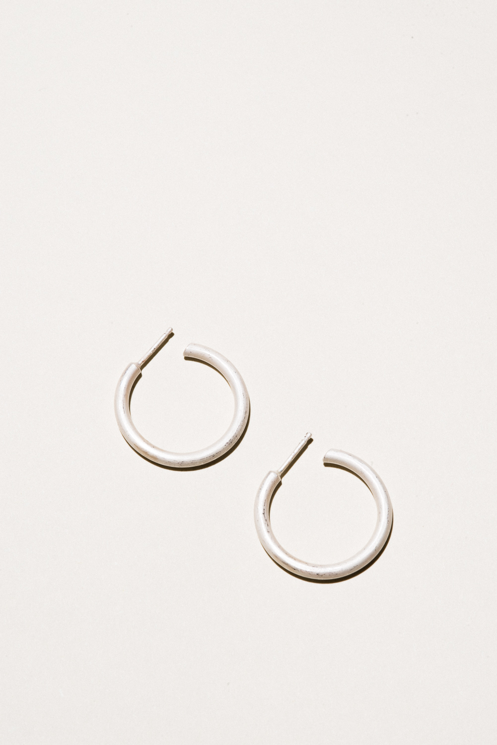 Medium Silver Classic Hoops - .9 in diameterSterling Silver, Raw FinishHand Smithed$90