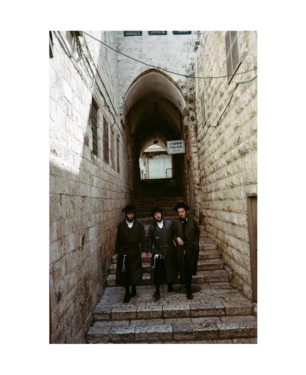 Three men in the Jewish Quarter, Old City, Jerusalem.
