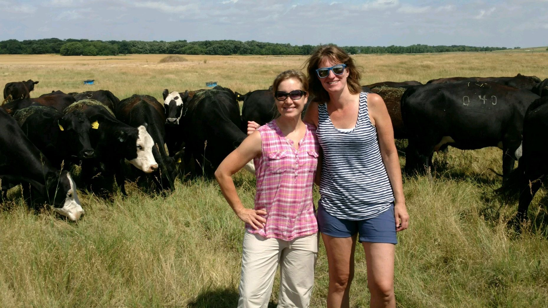 Field of Cows: The author (right), with her friend Tracey on the farm in Kansas.