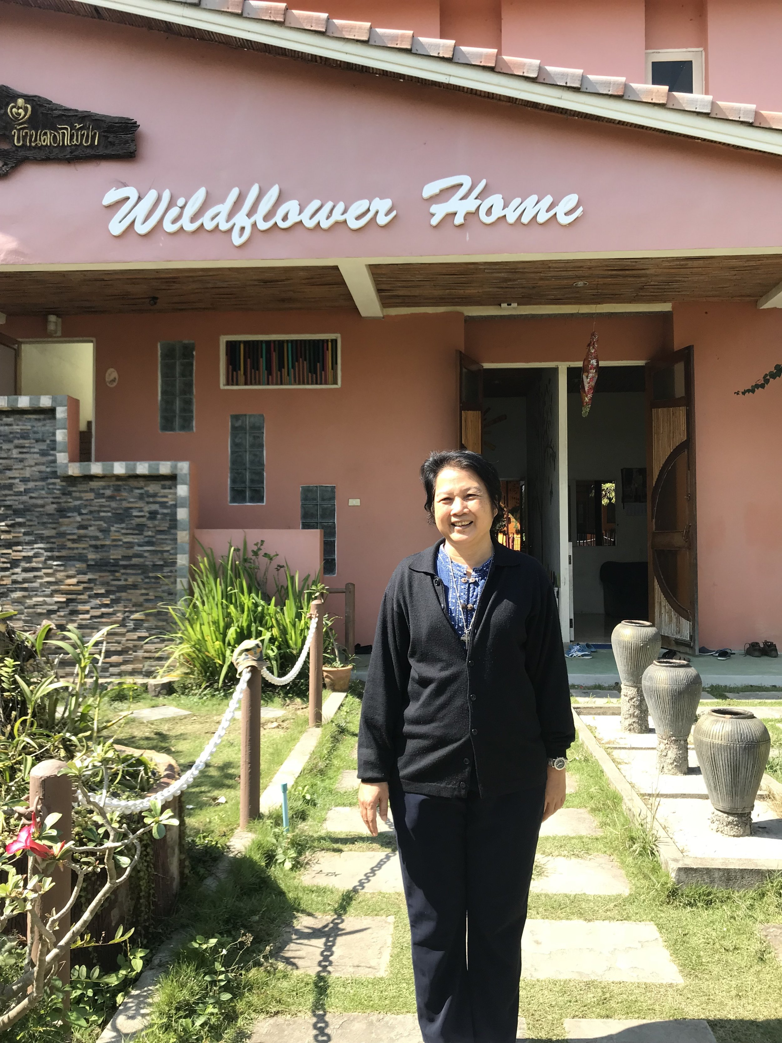 Sister Anurka in front of Wildflower Home.