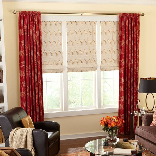 Make a statement with fabric roman shades and bold side panels