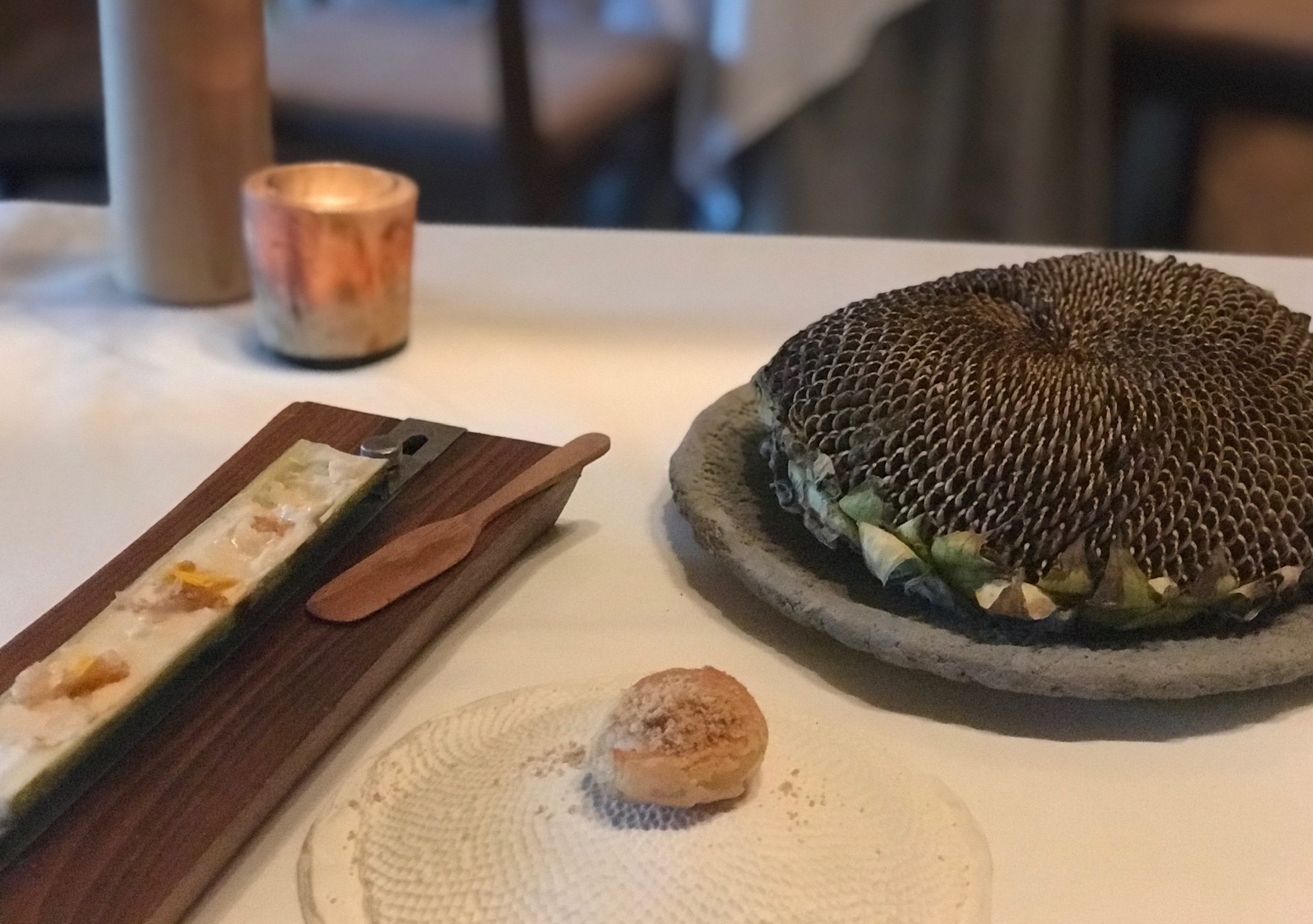 These two dishes, at left, were inspired by a sunflower farm recently acquired by Stone Barns. At right is a giant sunflower head.