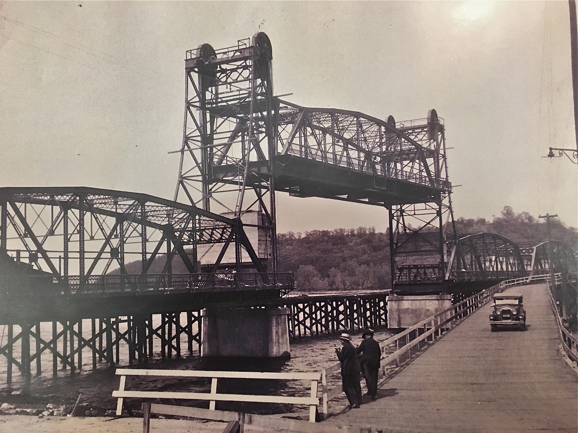 """Lift Bridge Under Construction While Pontoon Bridge Was In Use. The Year was 1931. Photo credit, Mr. John Runk, courtesy of the Stillwater Public Library.    To travel through the """"Time Tunnel"""" from 1875 to 1931, Click or Tap the photo above . Imagine yourself walking across the old wooden bridge onto the new lift bridge from 1875 to 1931 !"""