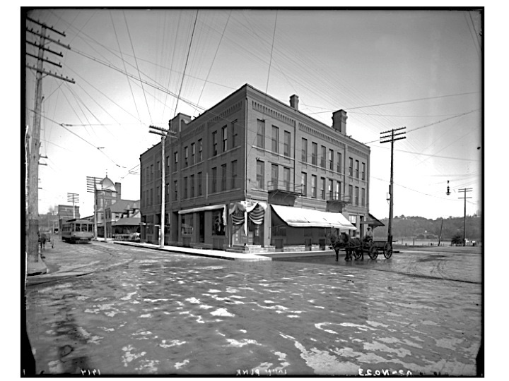 """The year is 1914 and the location is Chestnut and Water Street. The Lumbermen's Exchange Building is in the foreground. In the background is the Union Depot nearby is the Stillwater Trolley. Photo credit is Mr. John Runk courtesy of the Stillwater Public Library, John Runk Collection.   To view a """"Time-Tunnel"""" that allows you to travel from 1914 to 2016, just click or tap on the photo above."""