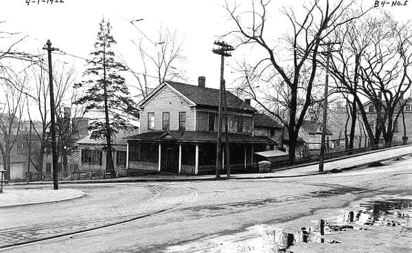 """This photo was taken in 1922. The location is 3rd and Chestnut Street, viewing to the southwest. The streetcar tracks are in the foreground. The house is no longer there, replaced by the Armory Building, which was retired in 2017.   To view a """"Time-Tunnel"""" photo of this same location that allows you to travel from 1922 to 2016, just Click or Tap the photo above."""