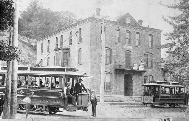 The year is 1893 and these are the first electric powered streetcars in Minnesota. The cars are located on 3rd Street and Chestnut,viewing toward the west. This was a busy intersection for the rail line, which involved negotiating a switch to allow the cars to go north/south on 3rd Street or east/west on Chestnut Street. The Stillwater Street Railway Company was short-lived for only a few years until it was revived by the Twin Cities Rapid Transit Company in 1899.