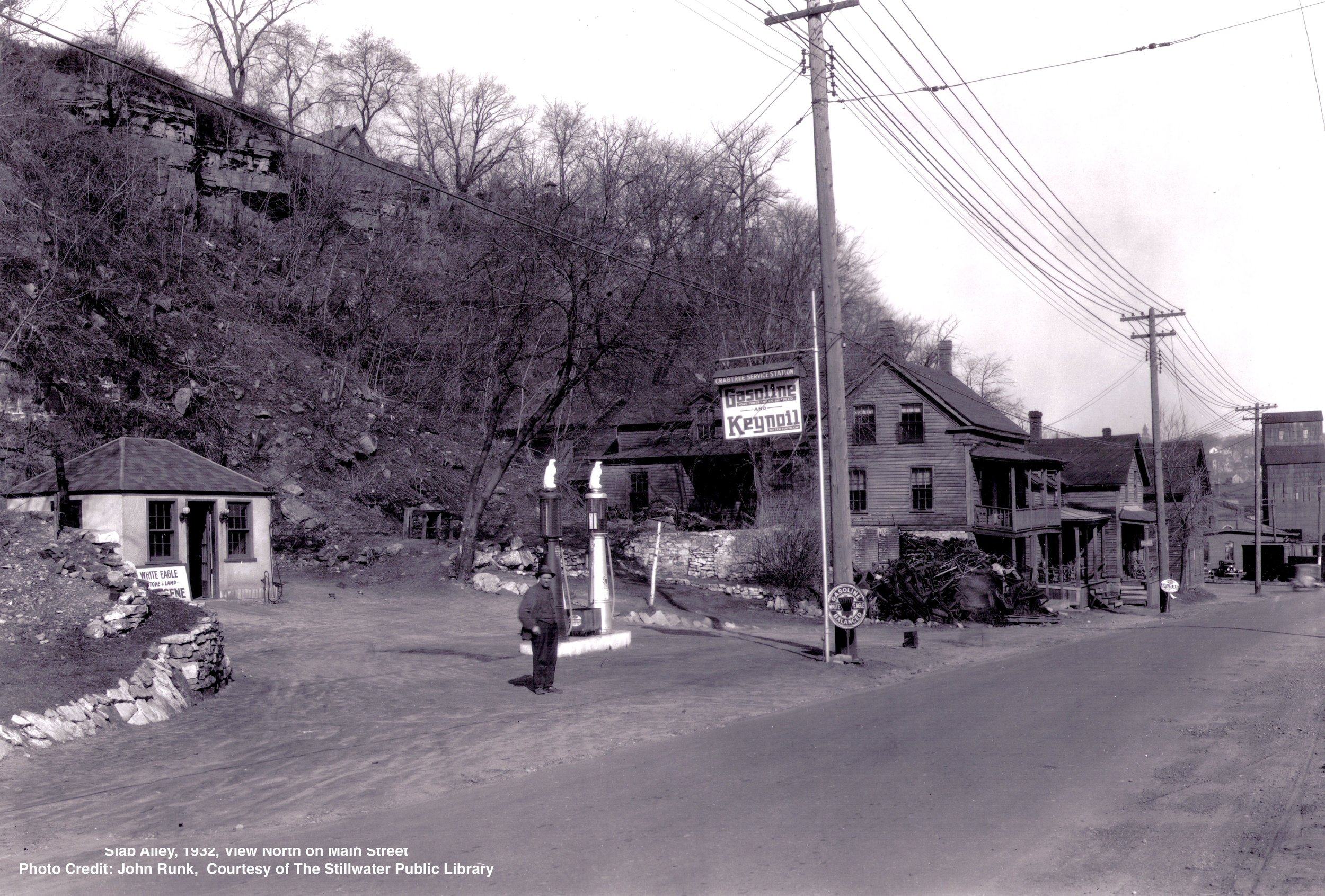 This was the location of the Crabtree Service Station in Slab Alley. The year was 1932. The view is toward the north. In the distance you can see the Commander Grain Elevator. It is the only building left in this photo.