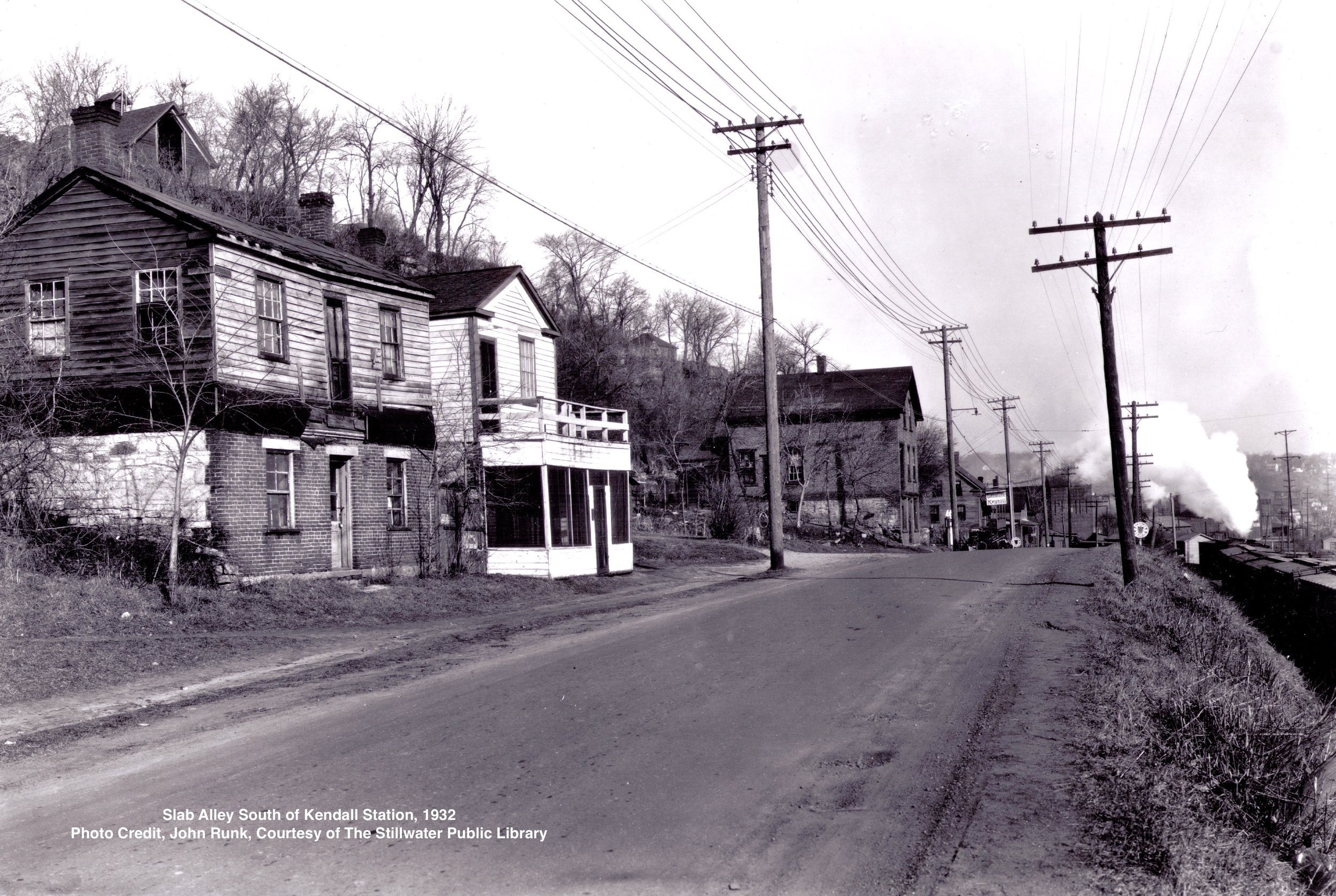 This photo was taken at a location about 1/4 mile south of the Crabtree Kendall Service Station. The year was 1932. The view is toward the north. All of these buildings were razed and these photos are all that remain of this busy area.