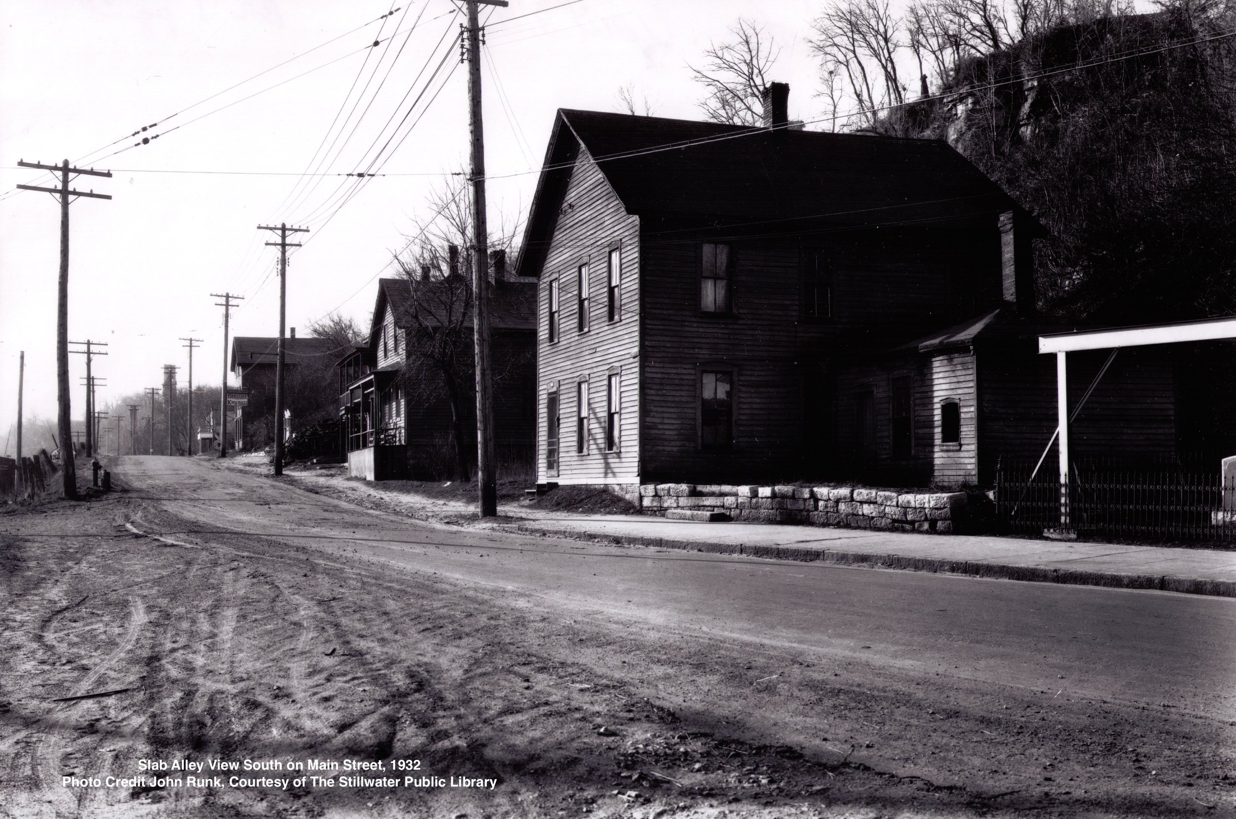 This is a view to the south of Slab Alley. The year was 1932. There was a lot of activity in Slab Alley at various times ranging from the Hersey Bean Lumber Mill operation to the railroad movement. In earlier years, there also Was a brewery just south of this location.