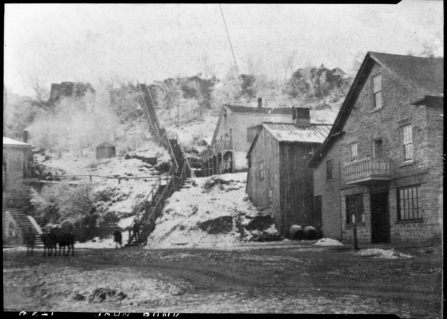 Another early view of the wooden stairs, this time with an additional series of stairs at the bottom. This photo is sourced from the John Runk Collection, courtesy of the Stillwater Public Library.
