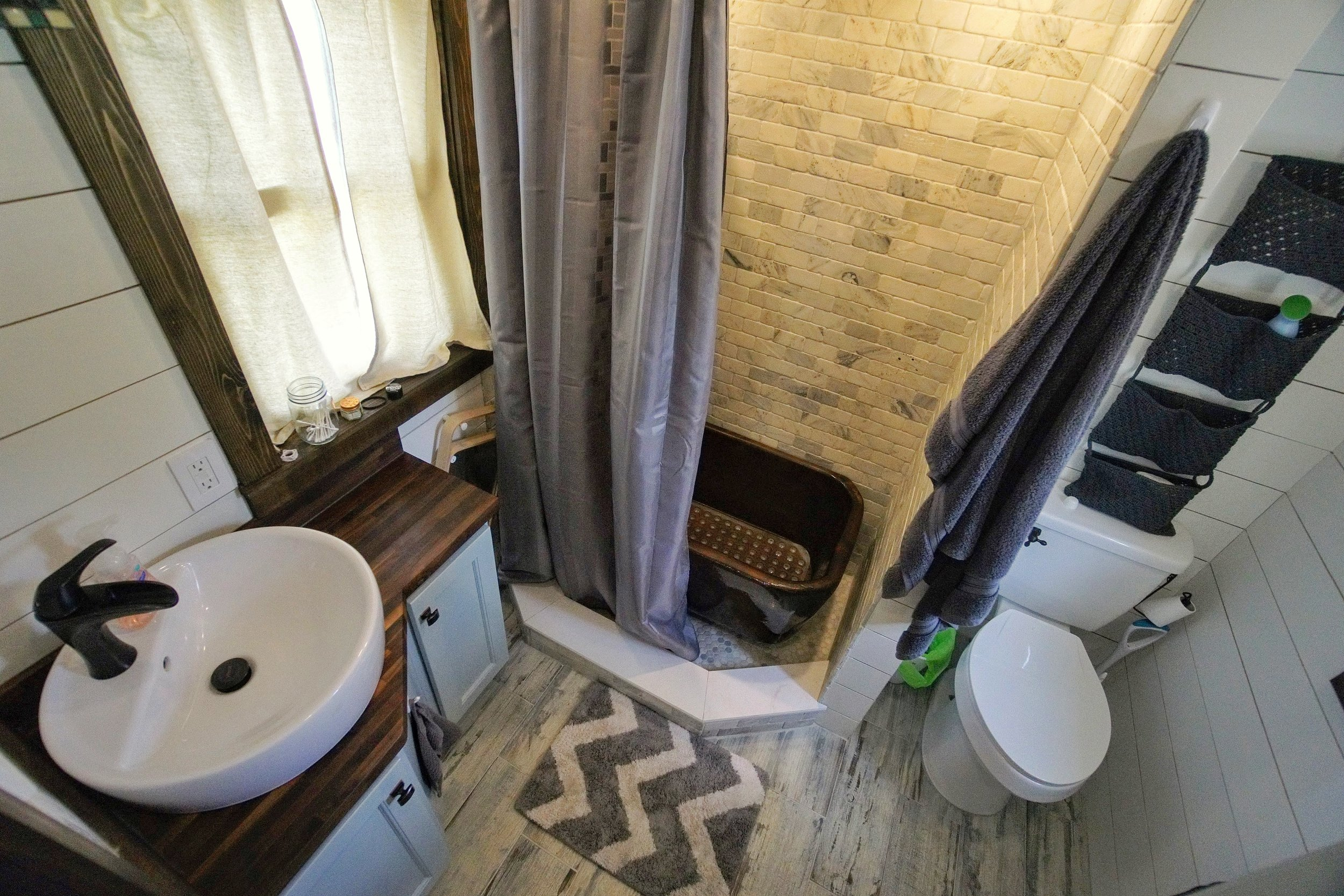 Tiny Home bathroom custom wooden tub marble subway tile shower