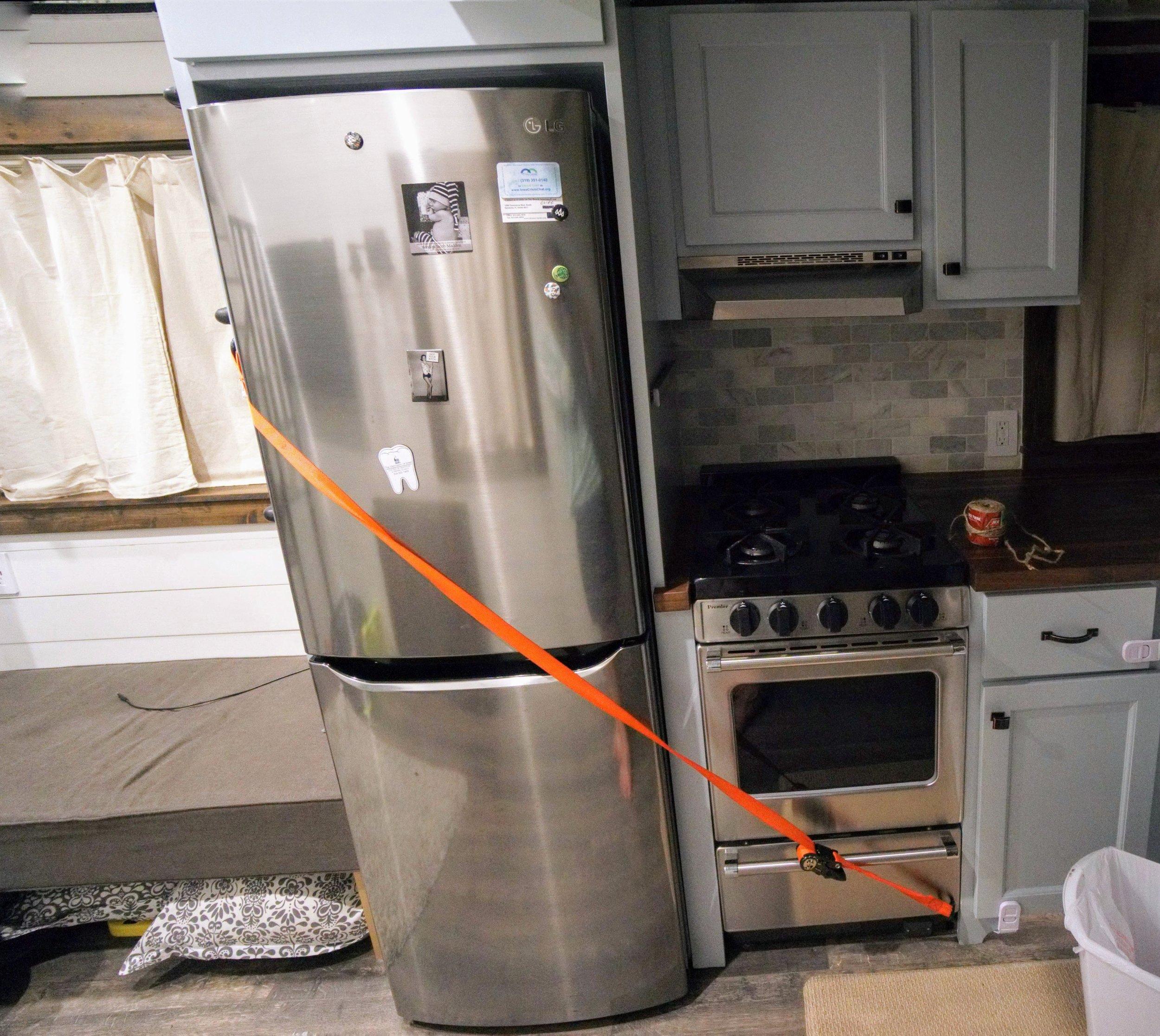 Moving a tiny home straps fridge