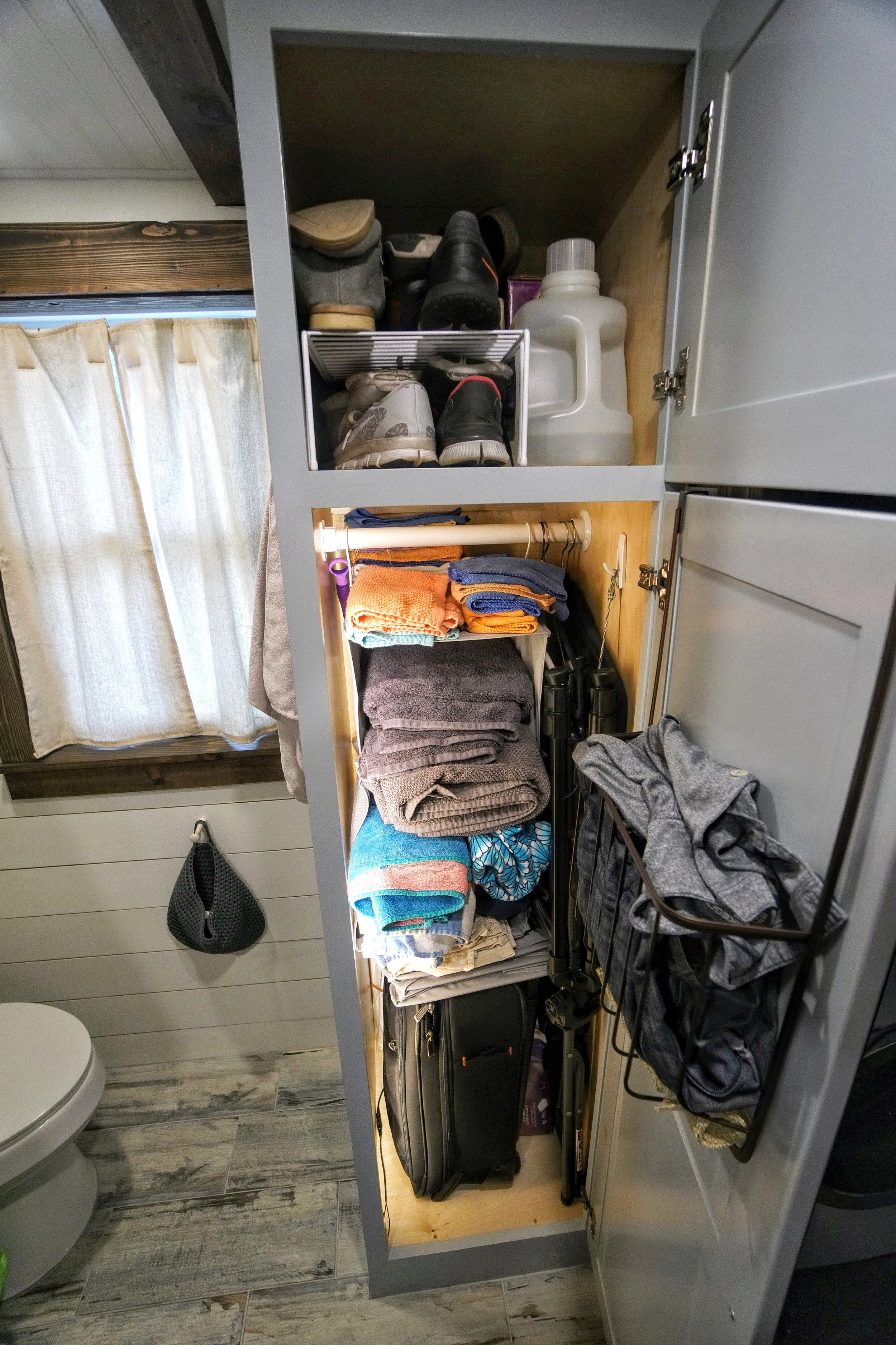 Tiny home organization closet space shoes bathroom tub shower clothes tiny house