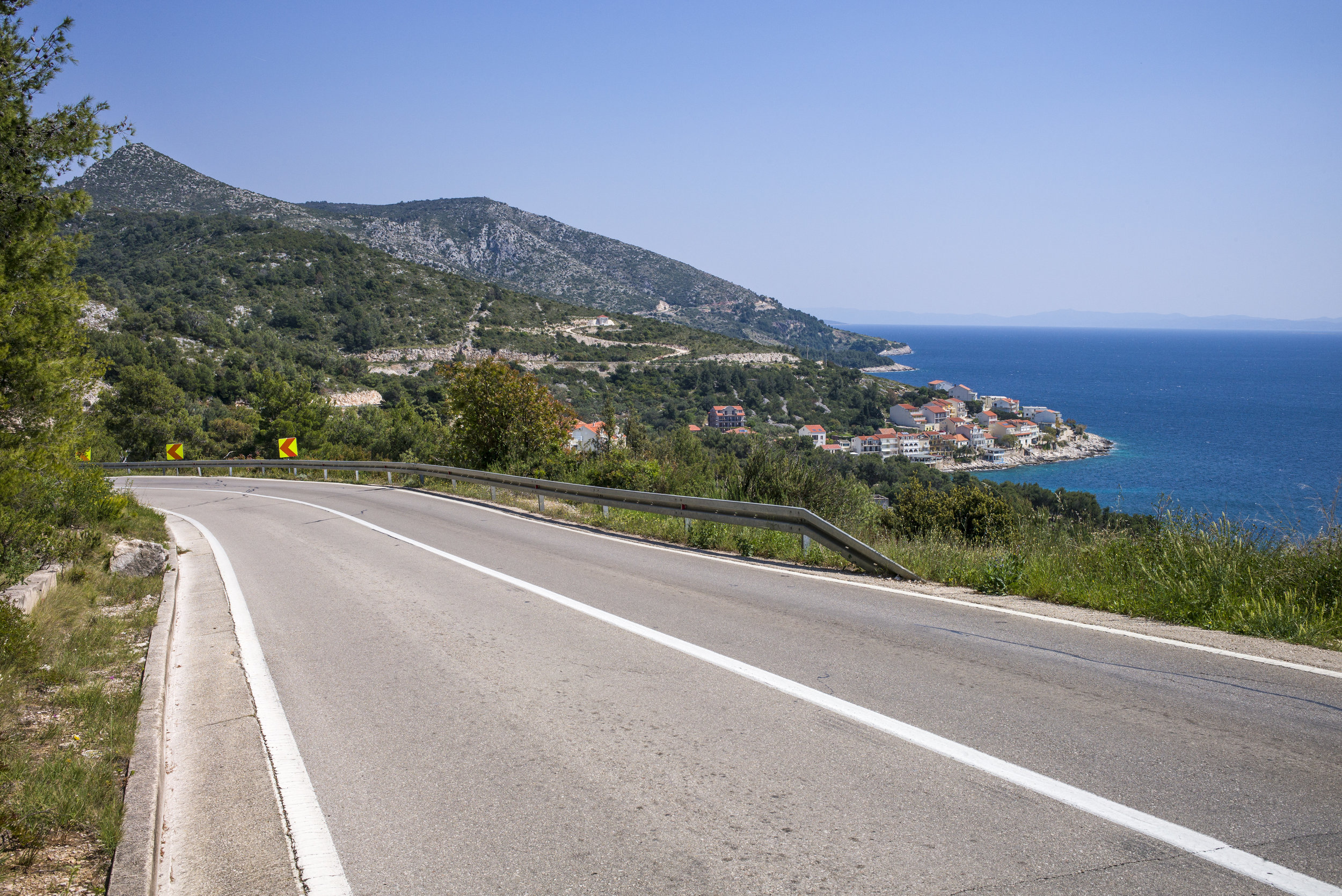 The winding road passes the small village of Milan on the Adriatic.