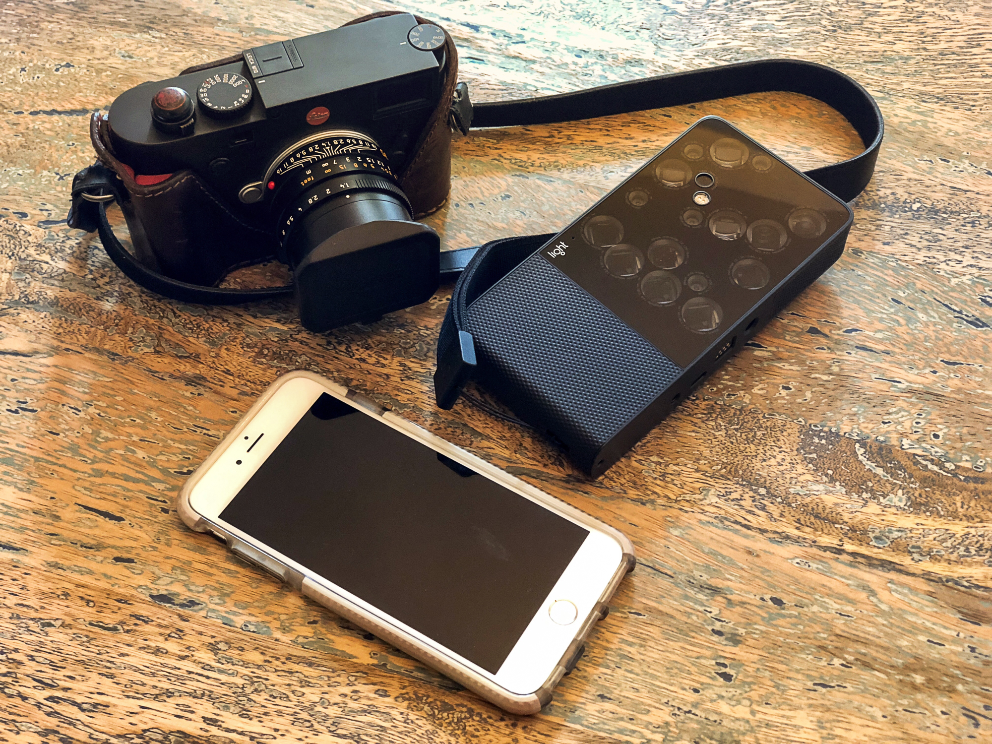 The Light L16 computational camera with 16 lenses,a Leica M10, and an iPhone.