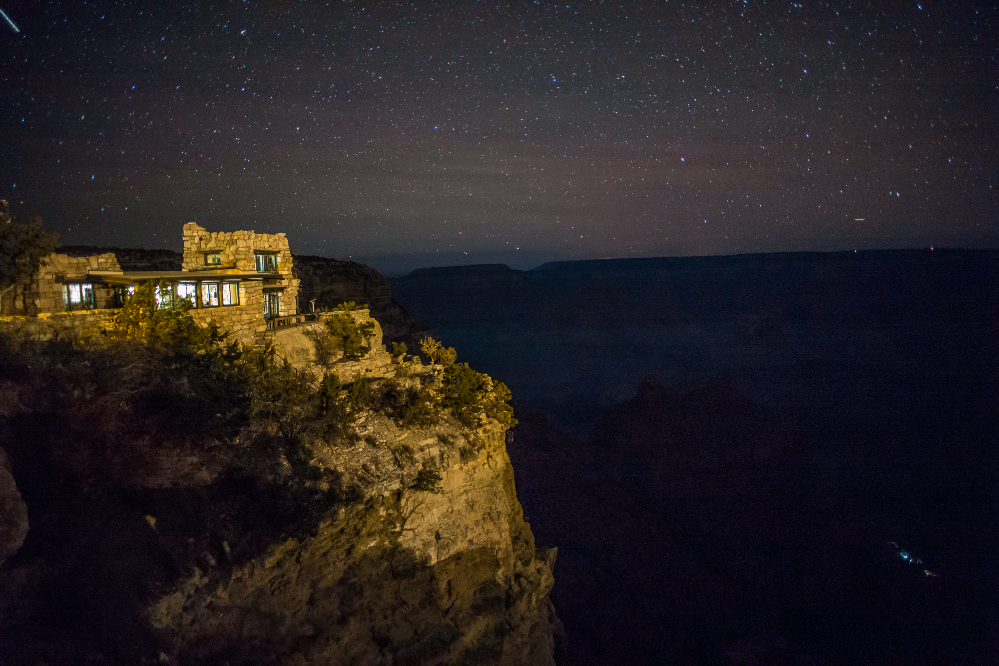 The Kolb studio at night with the lights of Indian Garden in the canyon
