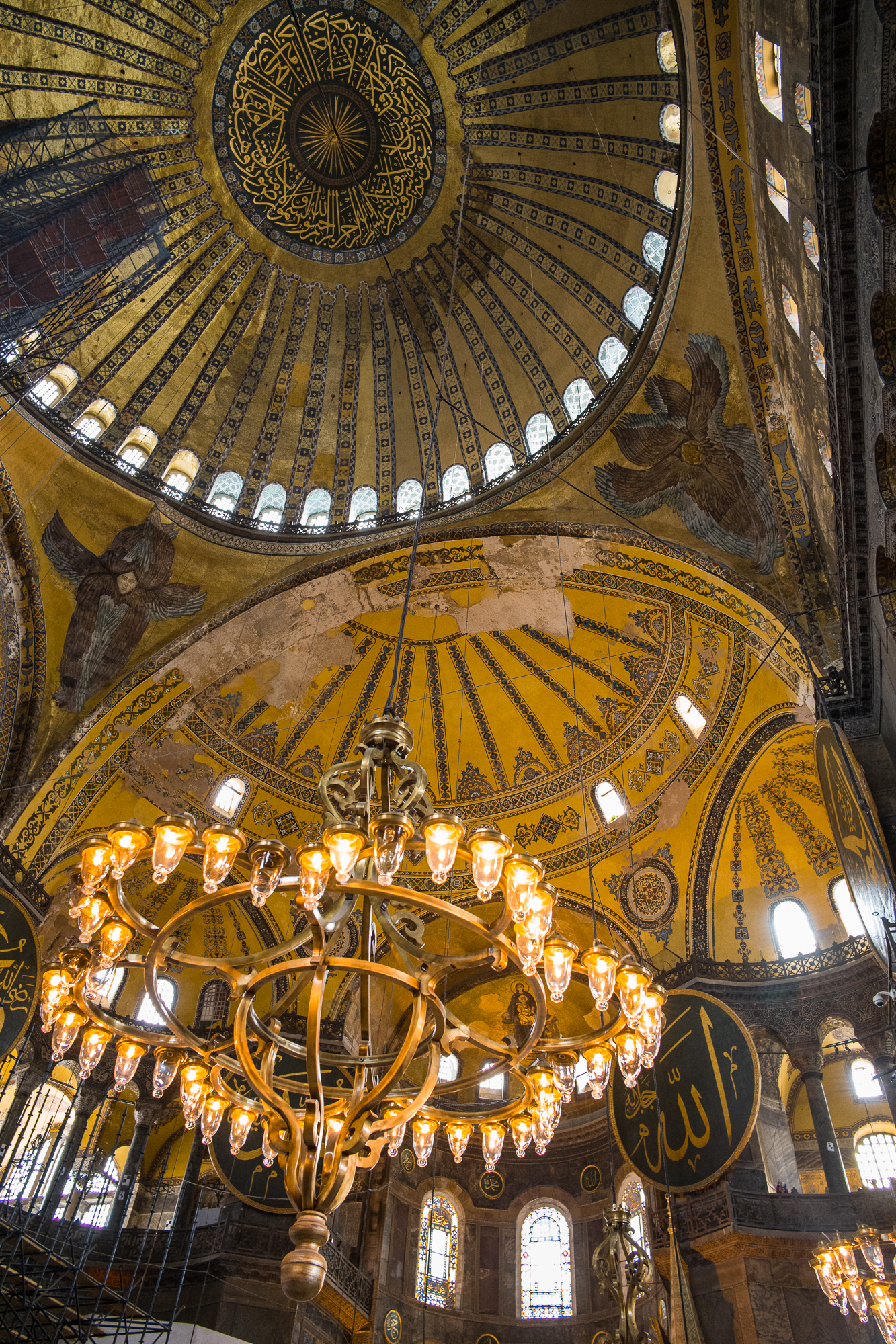 Inside the Hagia Sophia -six winged angels, Islamic calligraphy,mosaics,stained glass and a golden dome 180 feet high