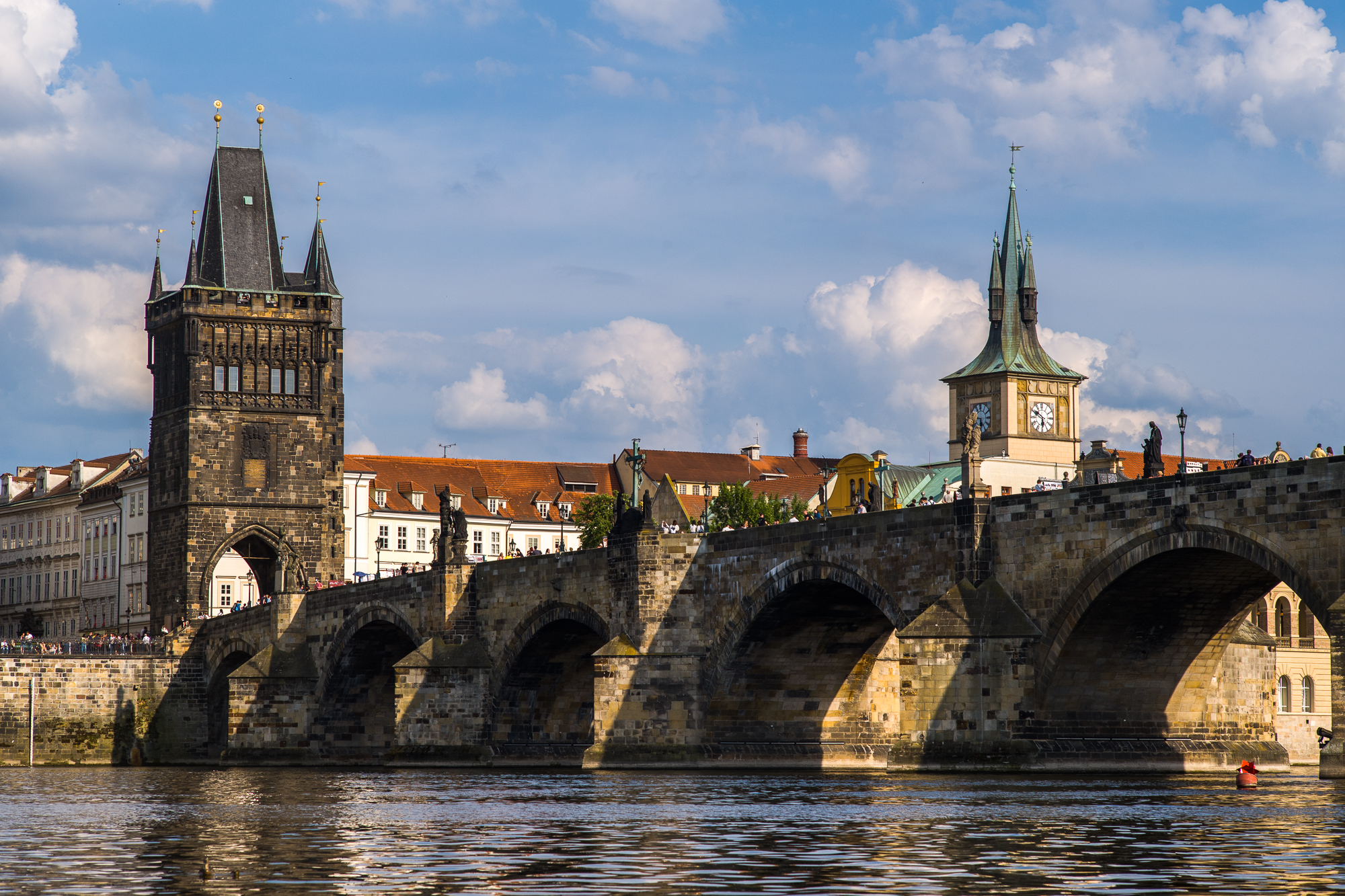 Charles Bridge seen from a boat on the Vltava River