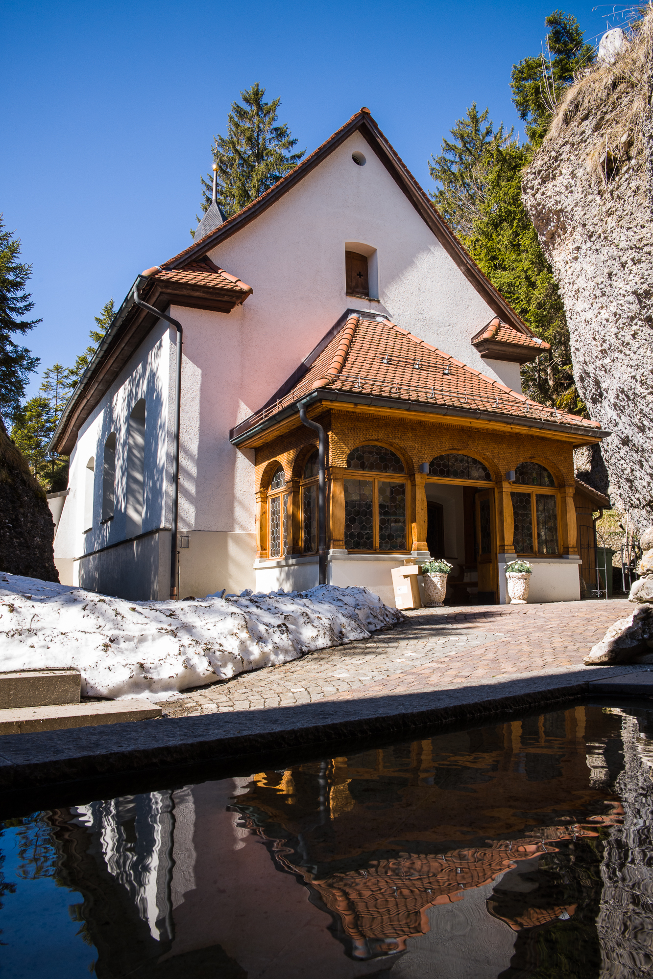 The Rigi Kaltbad chapel reflection in the spring flowing from the ancient riverbed