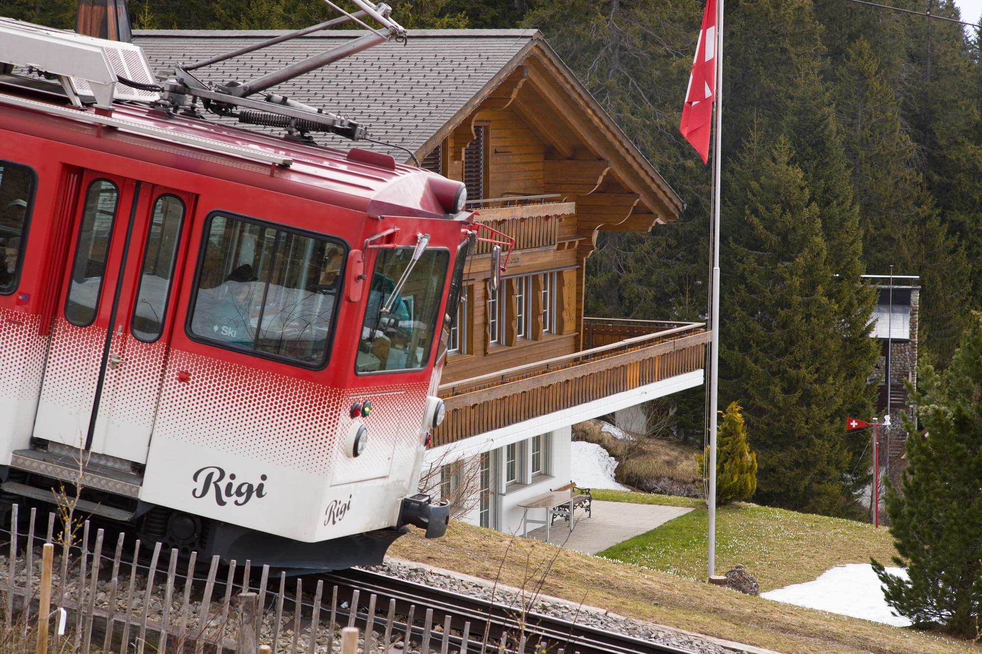 Rigi Rail passing a chalet