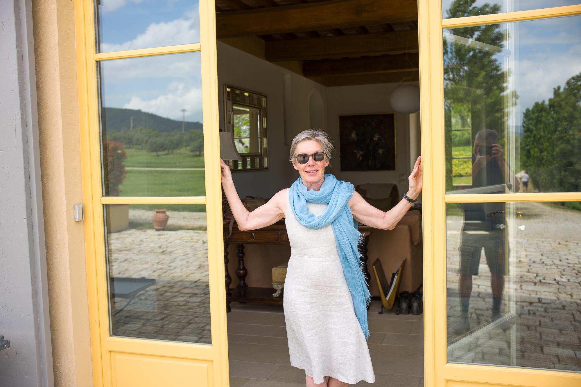 Cheryl greeting the Gang of Eight at Villa Oliveto
