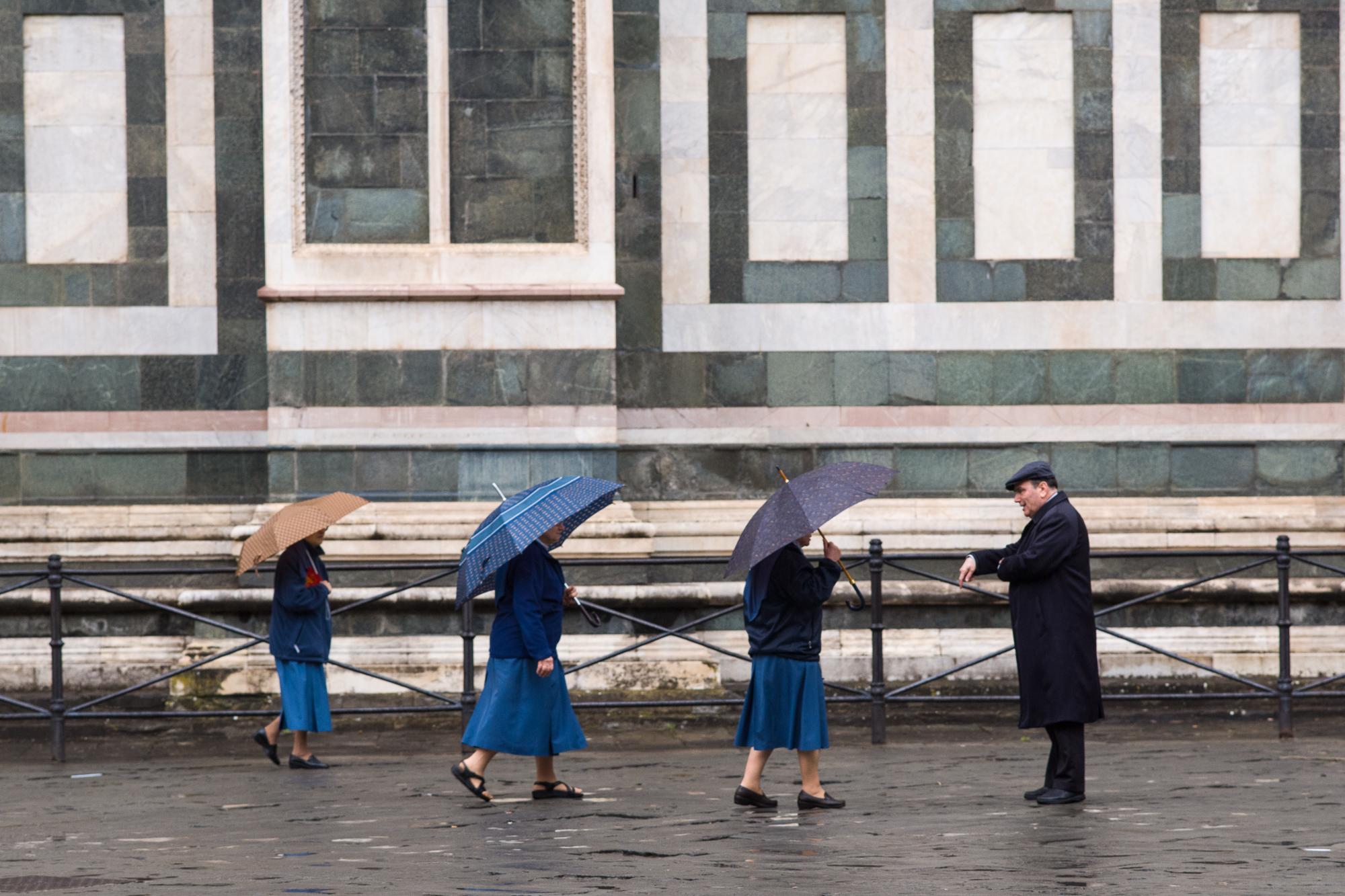 Nuns walking to morning prayers outside the Duomo