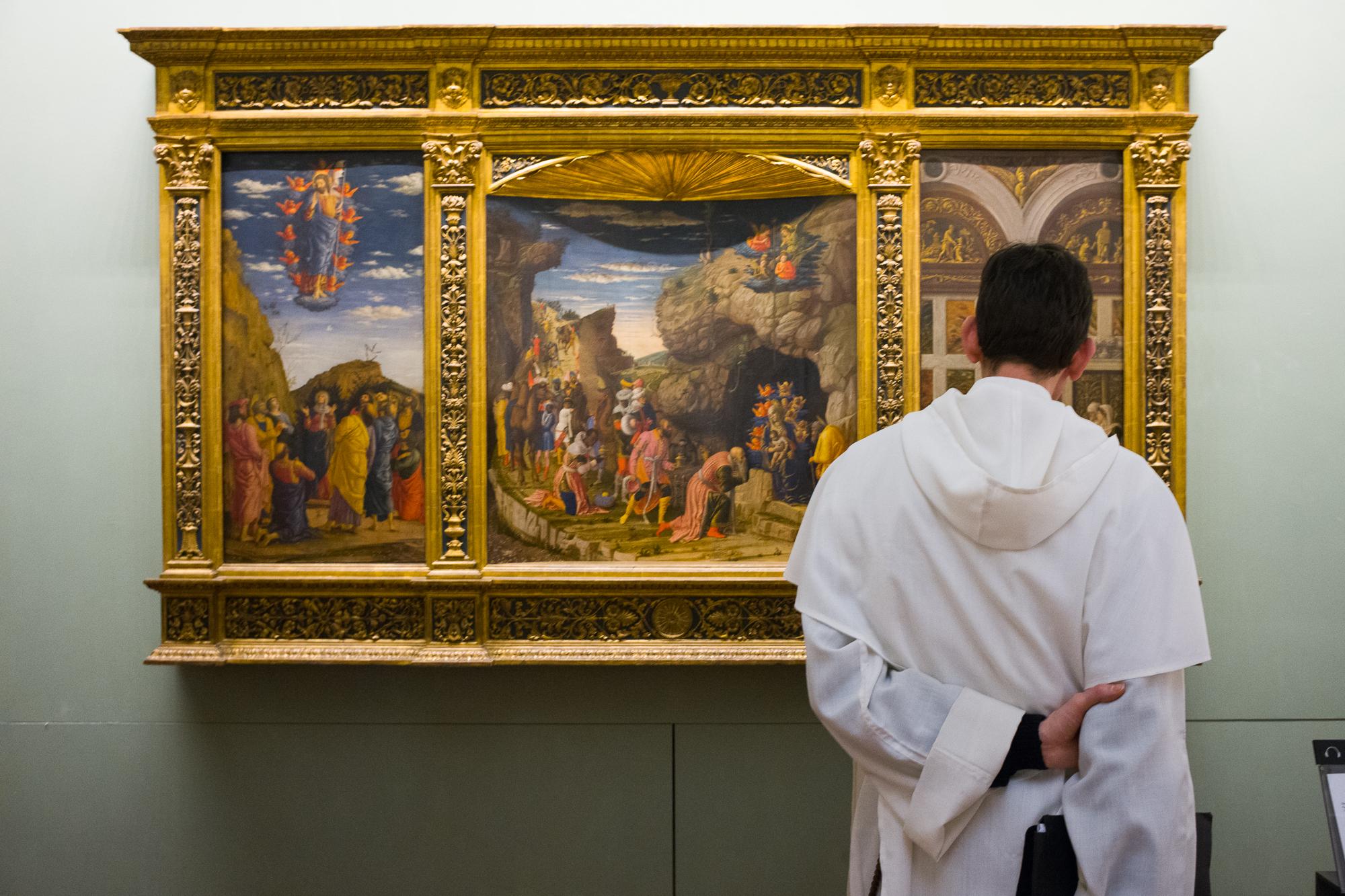 A priest enjoying sacred art at The Uffizi