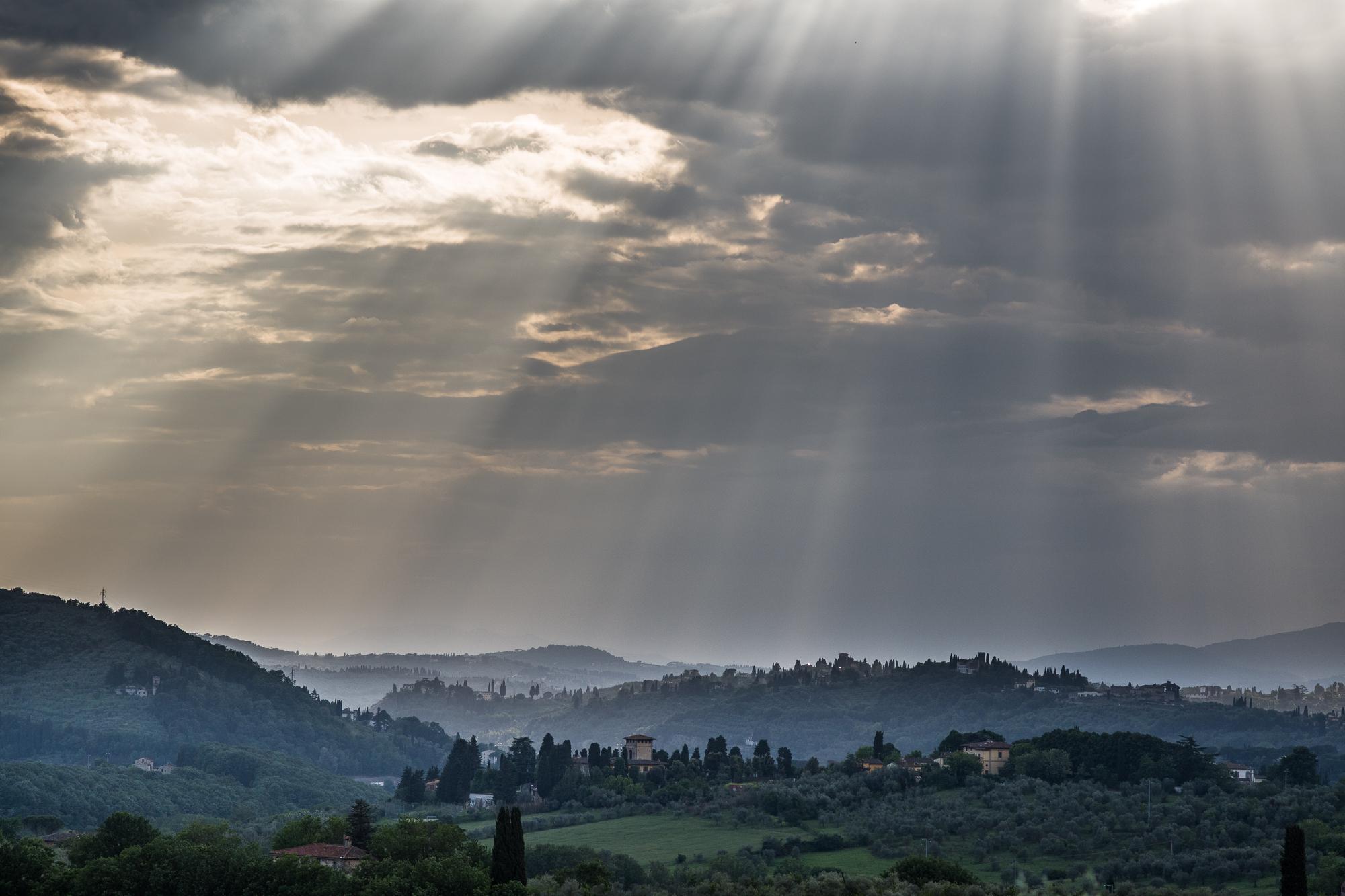 Tuscan hills with sun rays