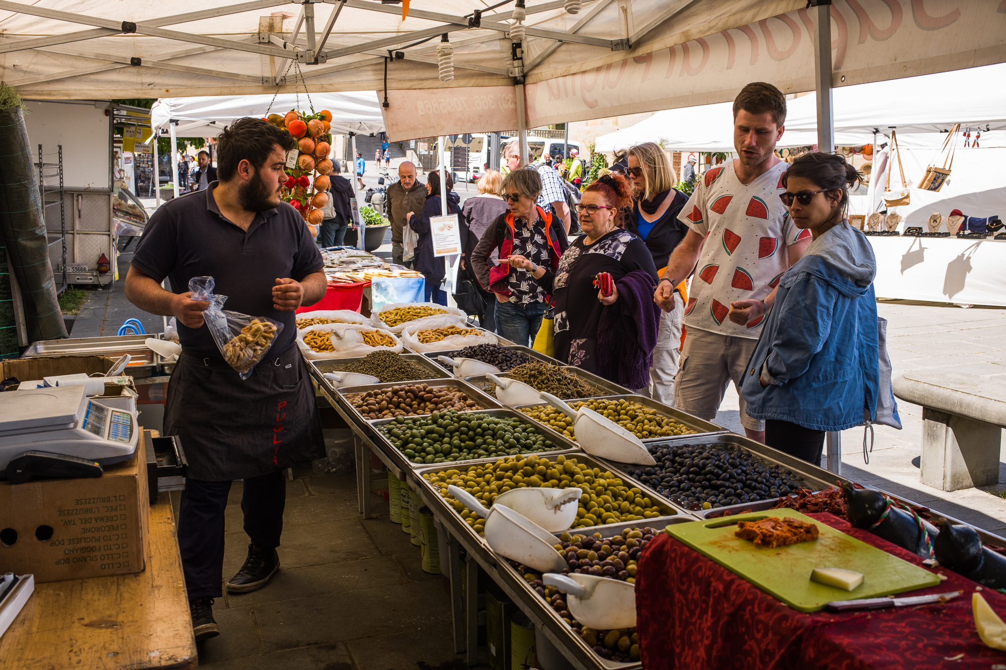 Buying olives in the market
