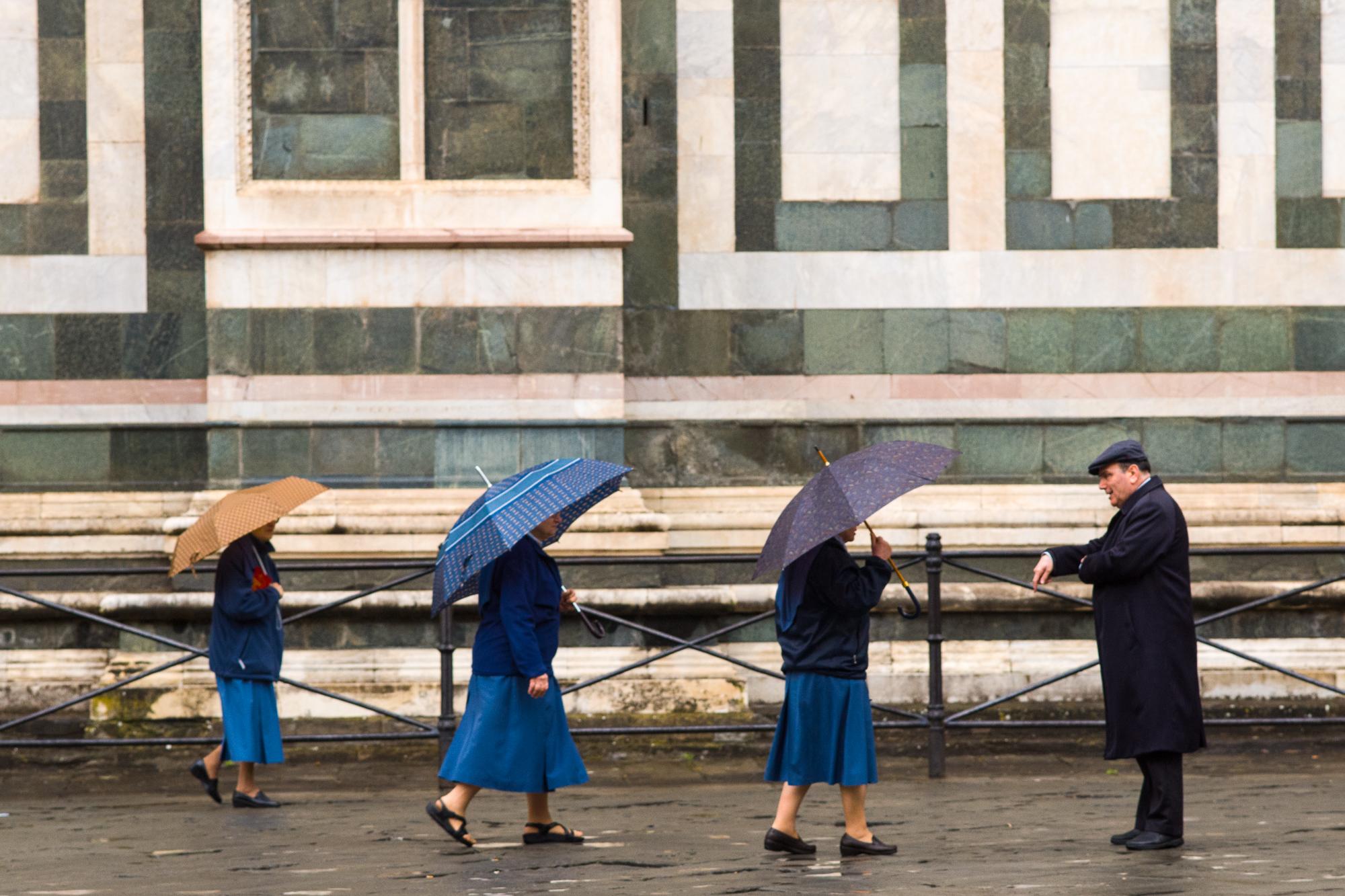 Nuns walking by the Duomo
