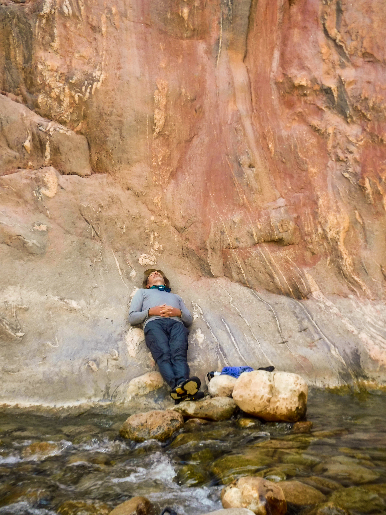 Me relaxing on the rocks worn smooth by eons of water flow.