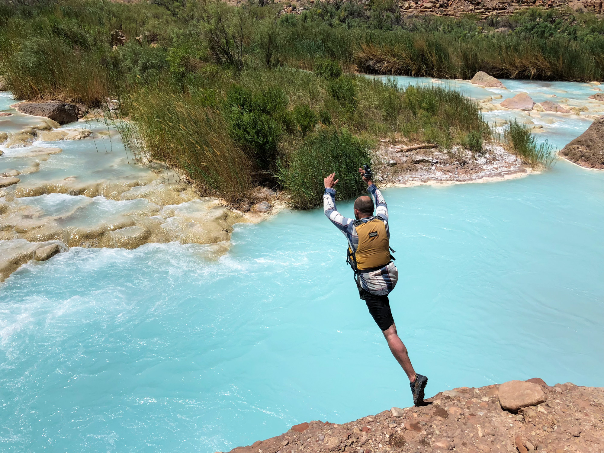 Jumping into the turquoise blue of the Little Colorado River